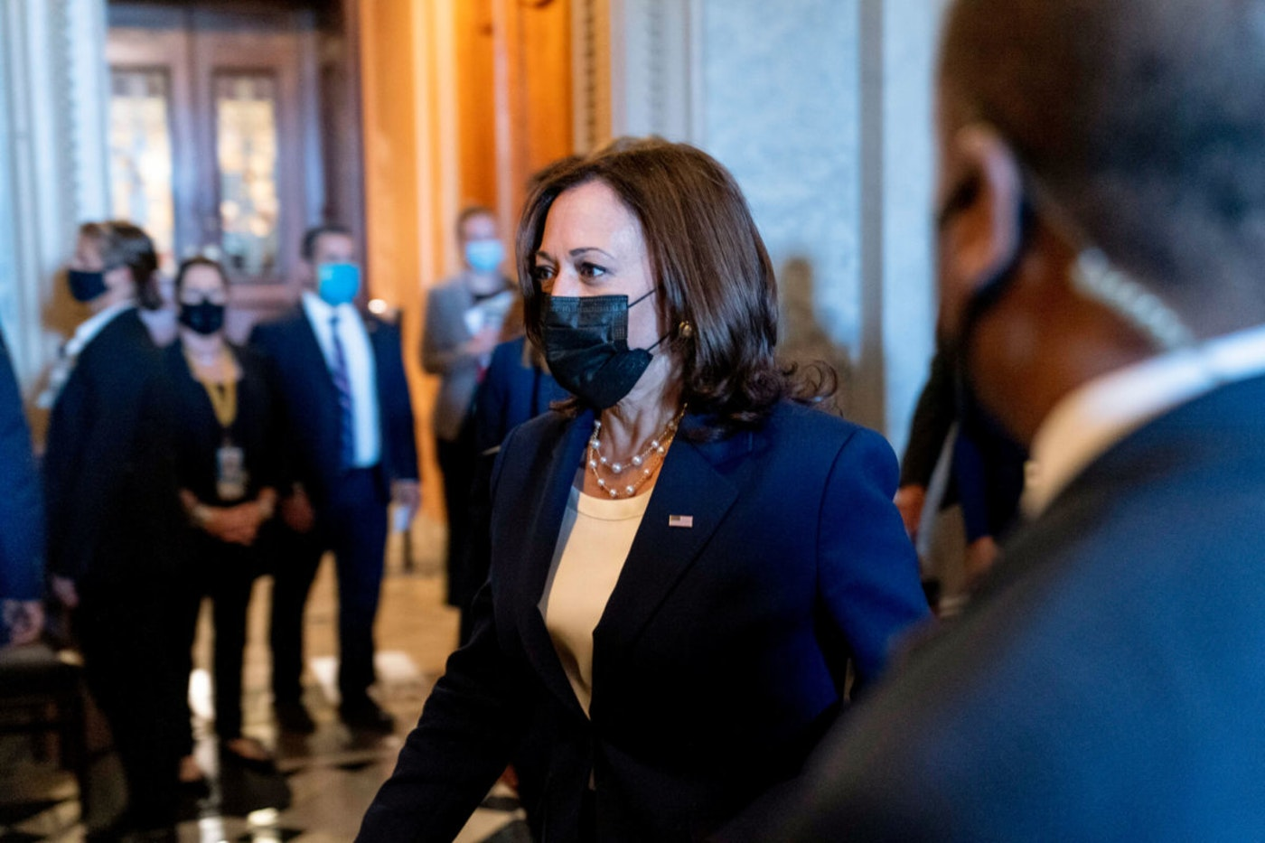 Vice President Kamala Harris walks off the Senate floor after voting on the $1 trillion bipartisan infrastructure package on Capitol Hill in Washington, Tuesday, Aug. 10, 2021. The Senate approved the bill, sending a cornerstone of the Biden agenda to the House. (AP Photo/Andrew Harnik)