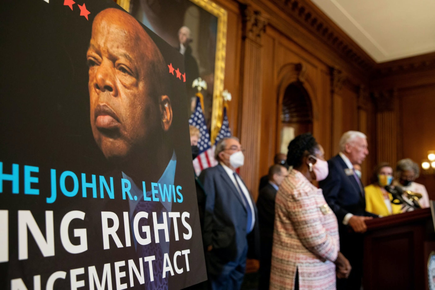 A poster bearing the image of voting rights icon John Lewis is seen during a news conference after the House of Representatives passed the The John Lewis Voting Rights Advancement Act in Washington, on Capitol Hill in Washington, on Tuesday, Aug. 24, 2021. (AP Photo/Amanda Andrade-Rhoades)