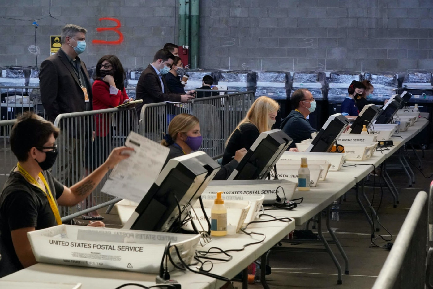 Election office workers process ballots as counting continues from the general election at the Allegheny County elections returns warehouse in Pittsburgh, Friday, Nov. 6, 2020. (AP Photo/Gene J. Puskar)