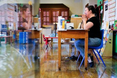 Tara Matise teaches her prekindergarten students virtually in her classroom prepared ahead of planned in-person learning at Nebinger Elementary School in Philadelphia, Friday, March 19, 2021. (AP Photo/Matt Rourke)