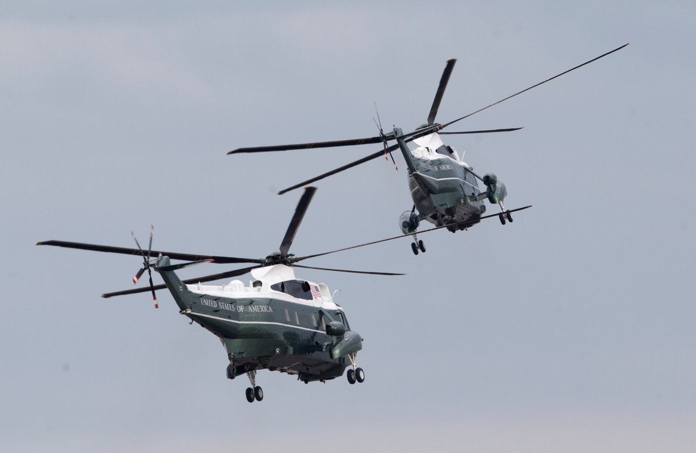 Two Marine Helicopter Squadron One (HMX-1) Sikorsky VH-3D Sea King helicopters depart Miami International Airport after a visit from then-President Barack Obama in 2015. (AP Photo/Wilfredo Lee)