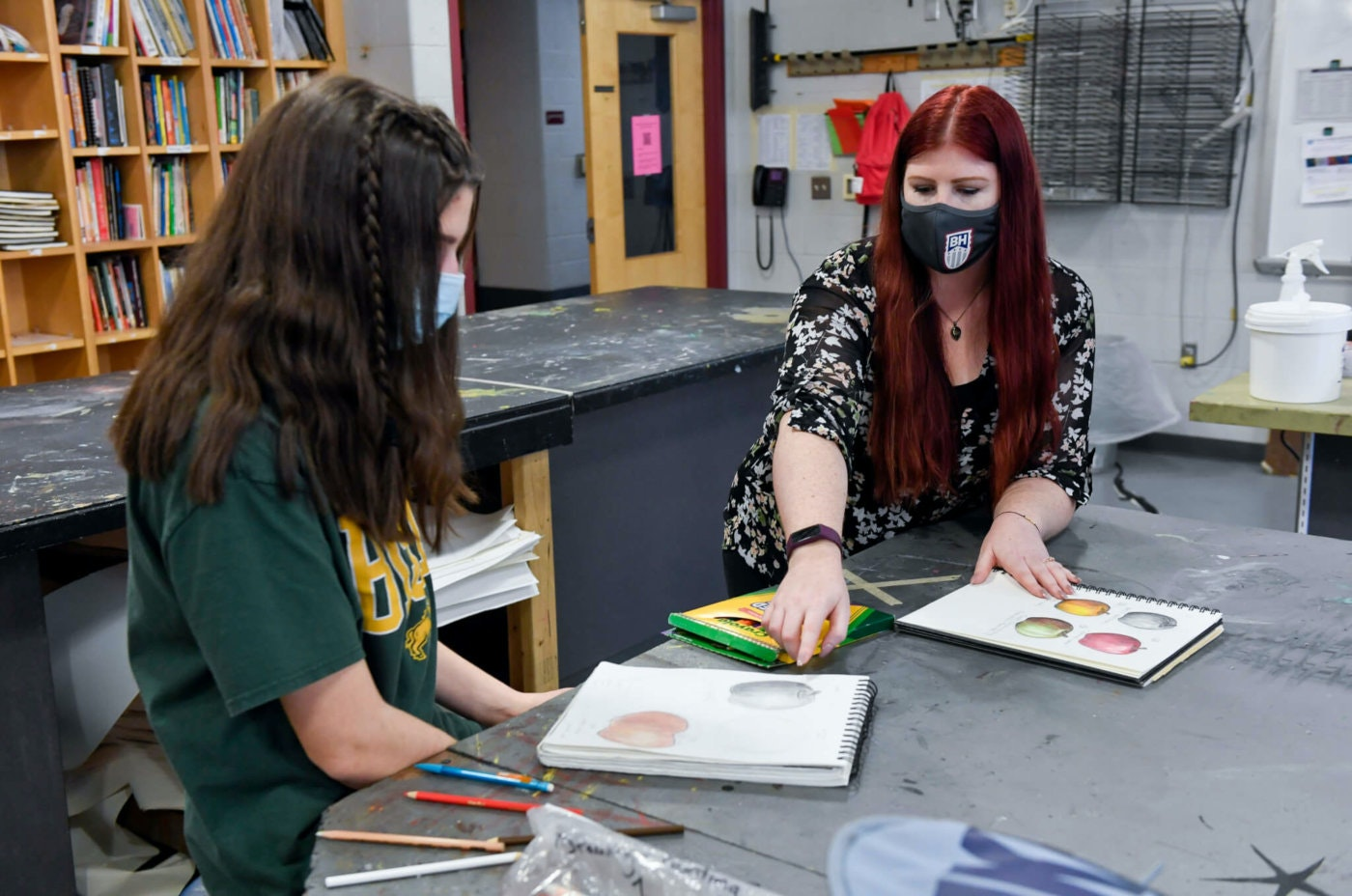 Angelina DeChristopher, a ninth grade student, works with Brandywine Heights High School art teacher Jennilee Miller on March 1, 2021, in Longswamp Twp. (Photo by Ben Hasty/MediaNews Group/Reading Eagle via Getty Images)