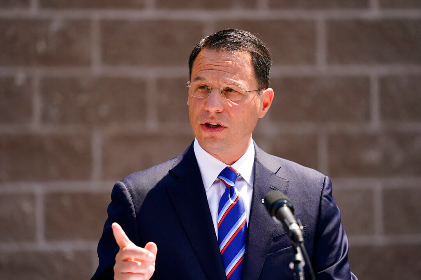 Pennsylvania Attorney General Josh Shapiro speaks with members of the media during a news conference in Darby, Wednesday, June 2, 2021. (AP Photo/Matt Rourke)