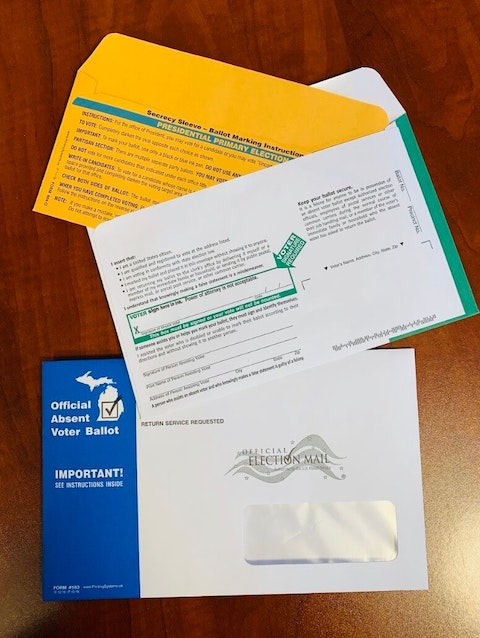 This year, Michigan's ballot envelopes have a new look. Envelopes containing absentee ballots are blue and white, and a green and white design has replaced the old brown manila return envelopes in a bid to make it easier for the United States Postal Service to process ballots.