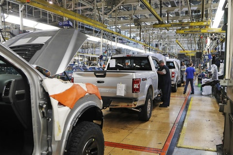 FILE - In this Sept. 27, 2018, file photo a United Auto Workers assemblymen work on a 2018 Ford F-150 trucks being assembled at the Ford Rouge assembly plant in Dearborn, Mich. The United Auto Workers union wants Detroit's three automakers to shut down their factories for two weeks to keep its members safe from the spreading coronavirus. But union President Rory Gamble says in an email to members obtained by The Associated Press that the companies were not willing to shut factories down. (AP Photo/Carlos Osorio, File)
