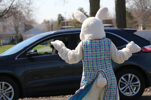 The Easter Bunny shows off his moves as a steady stream of families drive through.