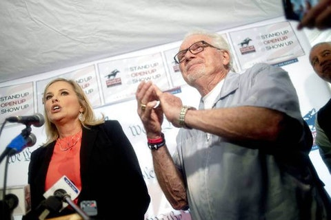 Texas hairstylist Shelley Luther speaks alongside barber Karl Manke during a press conference on Monday, May 18, 2020, outside of Karl Manke's Barber and Beauty in Owosso, Mich.