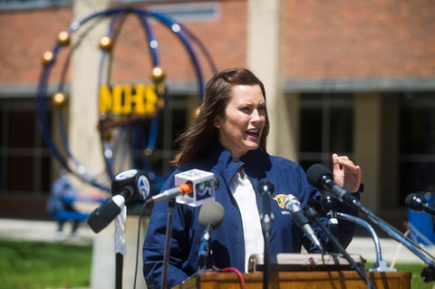 Michigan Gov. Gretchen Whitmer addresses members of the media and Midland County residents during a press conference at the temporary shelter at the school, Wednesday, May 20, 2020, in Midland, Mich. Whitmer spoke of response efforts to severe flooding caused by dam failures upstream of the Tittabawassee River. (Katy Kildee/Midland Daily News via AP)