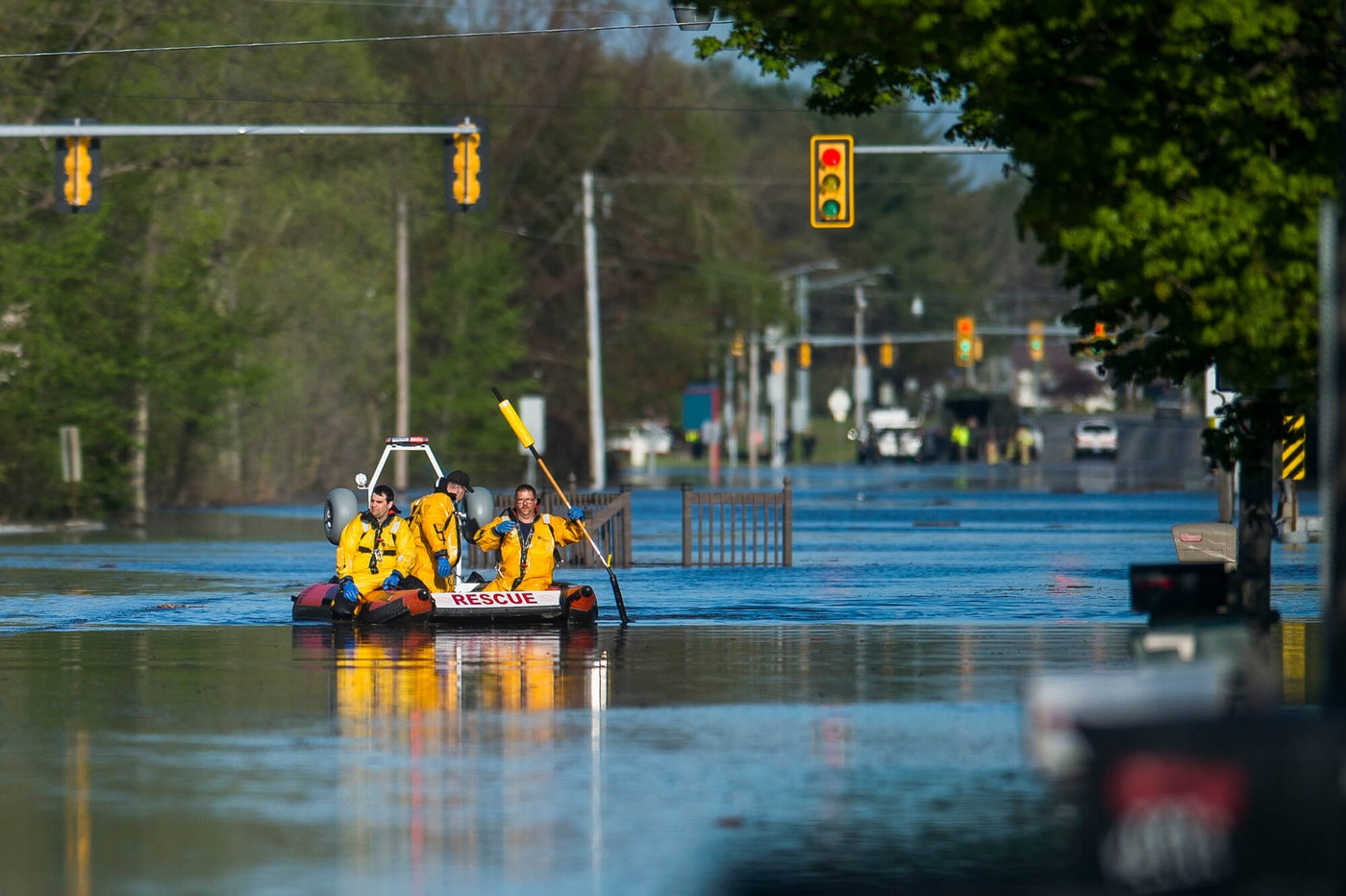 A search and rescue boat is deployed as Saginaw Road is closed at Drake due to water over the road while floodwater rises in Midland, Mich., Wednesday, May 20, 2020. (Katy Kildee/Midland Daily News via AP)
