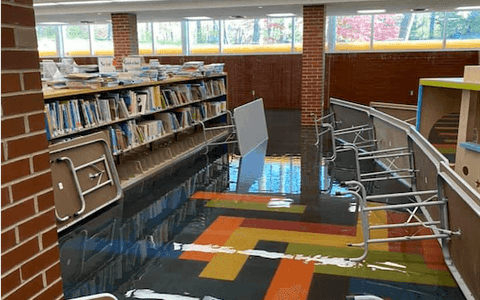 Library staff worked overnight to raise children's materials off the bottom shelves before it got wet and the Michigan National Guard worked then to bring the materials upstairs and out of the damp air. (Photo via Grace A. Dow Memorial Library Facebook page)