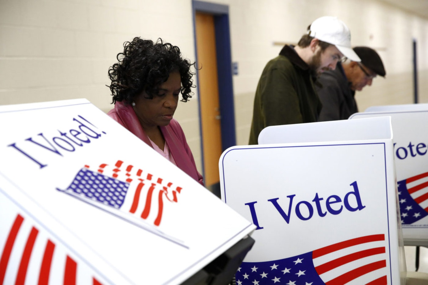 Voters fill out their ballots at a primary polling place, Saturday, Feb. 29, 2020. (AP Photo/Patrick Semansky)