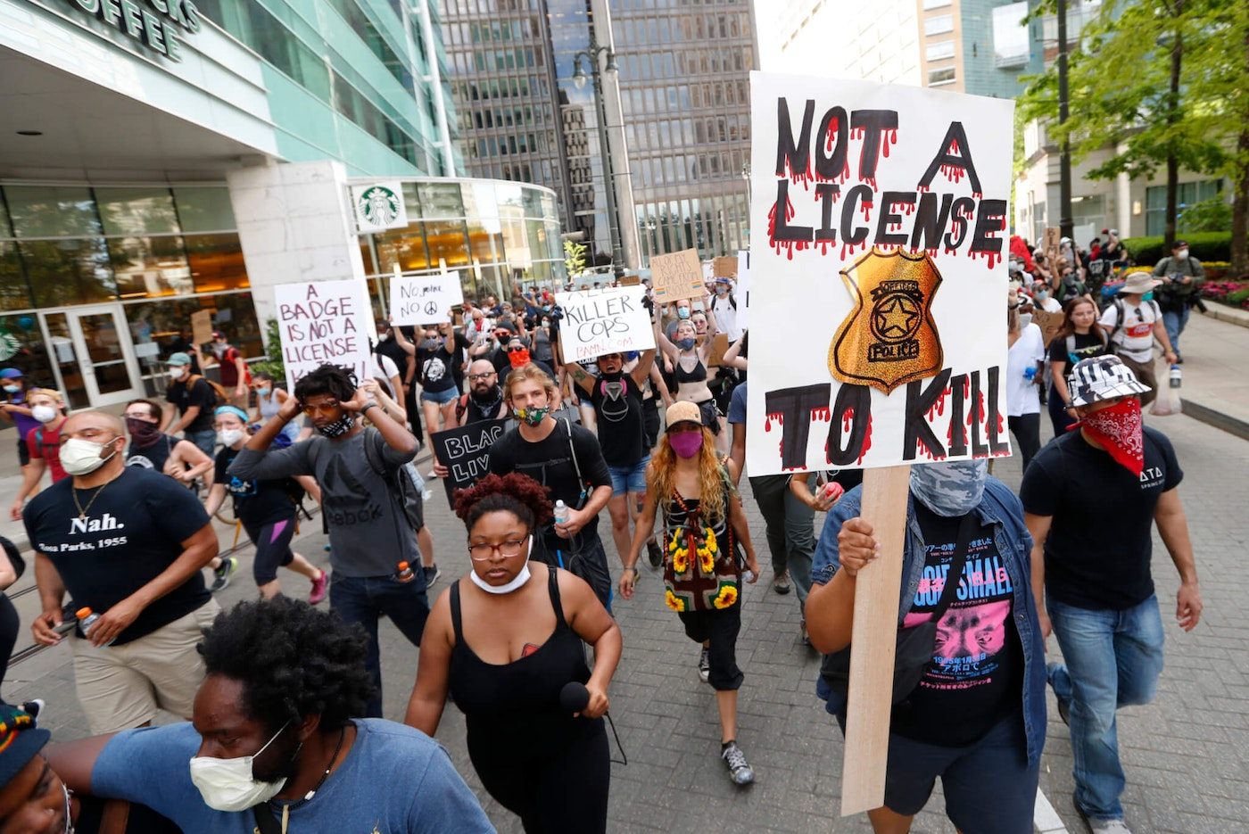 Protesters march during a rally in Detroit, Wednesday, June 3, 2020 over the death of George Floyd, a black man who died in police custody in Minneapolis on Memorial Day. (AP Photo/Paul Sancya)