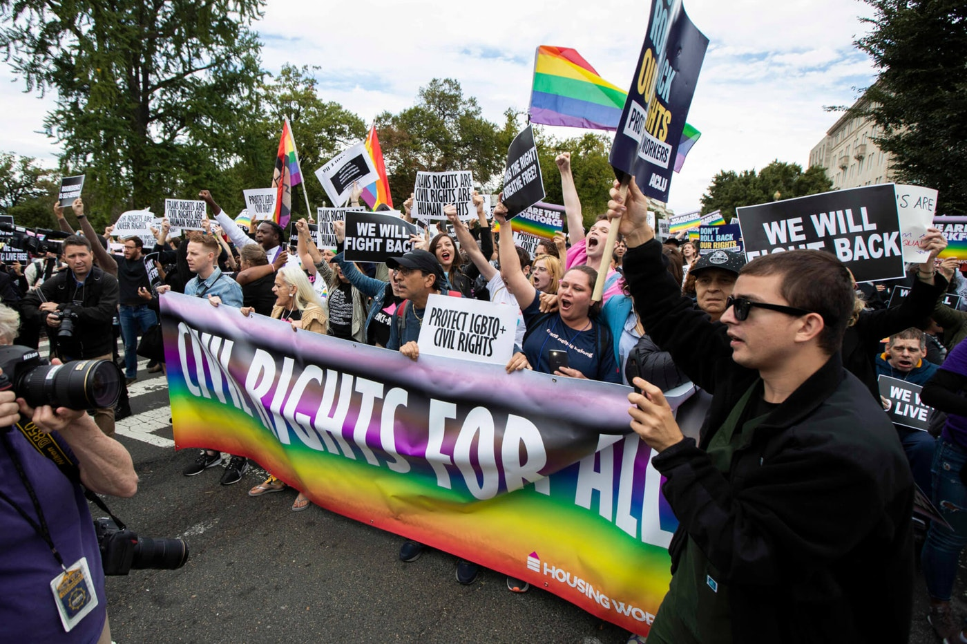 In this Oct. 8, 2019 file photo, supporters of LGBT rights stage a protest on the street in front of the U.S. Supreme Court in Washington. The Supreme Court has ruled that a landmark civil rights law protects gay, lesbian, and transgender people from discrimination in employment. It's a resounding victory for LGBT rights from a conservative court. (AP Photo/Manuel Balce Ceneta, File)