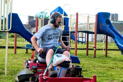 Mower Gang member Tim Wood gets to work cleaning up Berry Elementary School's playground on June 24, 2020. (Photo by Adam Fox-Long)