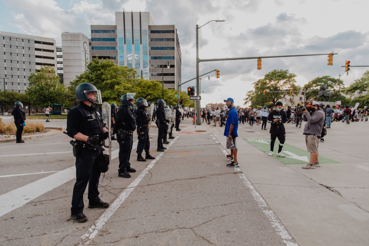 A local man appeals to Detroit Police. Photo by Franz Knight