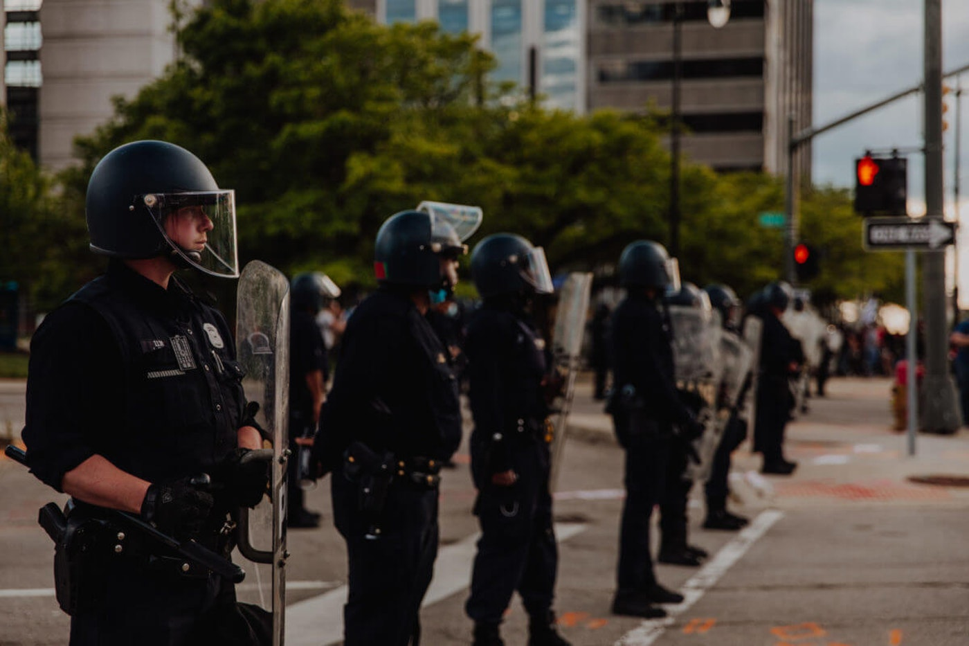 Police in riot gear dispatched to de-escalate a protest in Detroit. (Photo by Franz Knight)