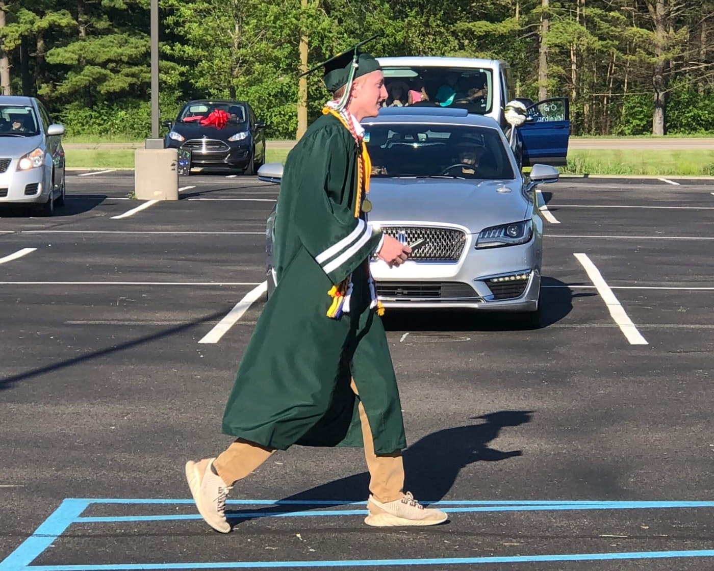 Valedictorian Austin Carrell finally gets to wear his cap, gown and cords. (Photo by Rachel Spall)