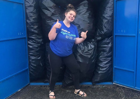 Isabella Borruso stands in front of one of three storage units packed to the brim with bottles and cans. Not pictured: 4+ full garages. (Photo courtesy Isabella Borruso)