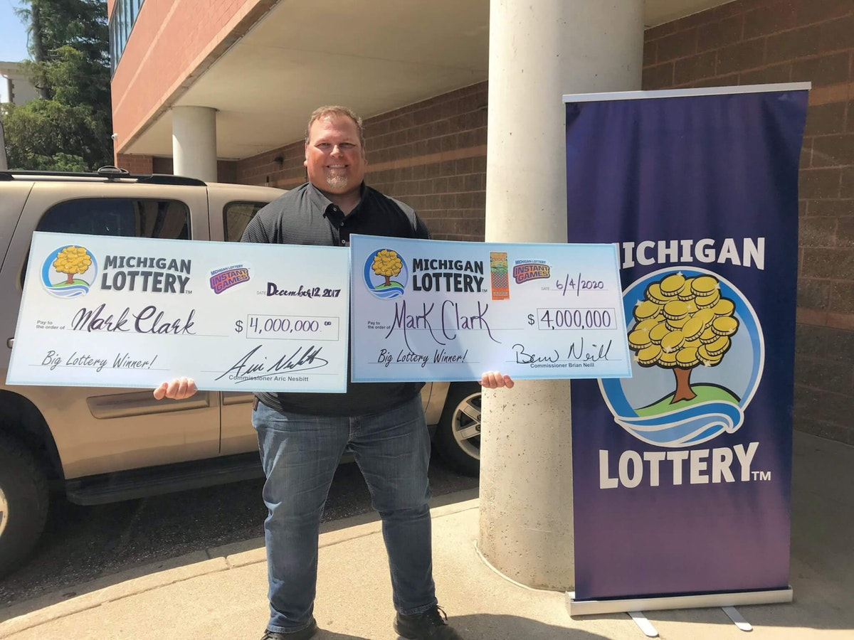 Mark Clark displays his two payouts from the Michigan Lottery. (Photo via Michigan Lottery Connect)