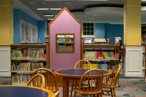 A bright and colorful children's center at the library encourages kids to have fun while reading in Plymouth, Michigan. (Photo via Shutterstock)