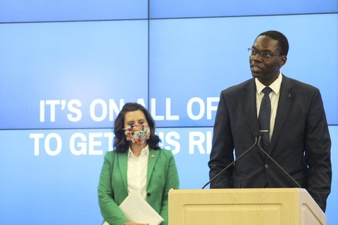 Whitmer and Gilchrist address protesters at press conference.