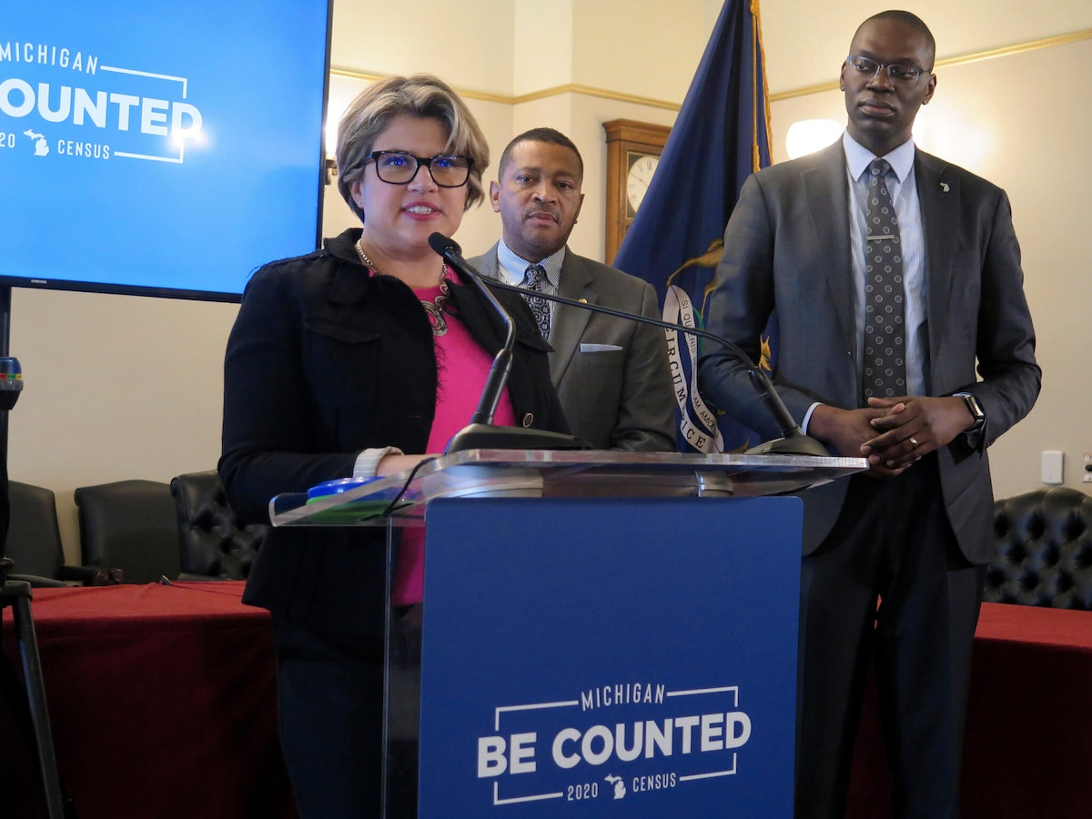 """Kerry Ebersole Singh, left, Michigan's statewide census director, helps to announce the kickoff of """"Be Counted,"""" a campaign to promote participation in the 2020 census, on Wednesday, Feb. 26, 2020, at the Capitol in Lansing, Mich. Also shown are Lt. Gov. Garlin Gilchrist, right, and state Rep. Tyrone Carter, D-Detroit, center. (AP Photo/David Eggert)"""