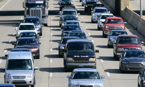 In a June 23, 2015, file photo, traffic heads north along the Lodge freeway in Detroit. But traffic has thinned out during the pandemic: Insurers are refunding Michigan drivers between 15% to 20% of their premiums due to a drop in driving and crash claims. (AP Photo/Carlos Osorio, File)