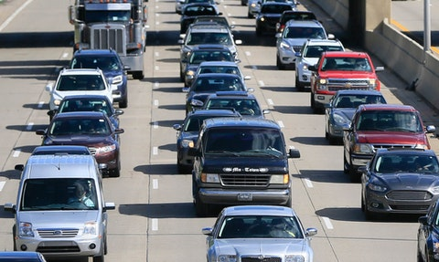 In a June 23, 2015, file photo, traffic heads north along the Lodge freeway in Detroit. Michigan drivers will have choices to make when they renew or buy a new auto insurance policy under a law taking effect Thursday, July 2, 2020. Motorist can buy unlimited personal injury protection, but it will no longer be mandatory. (AP Photo/Carlos Osorio, File)
