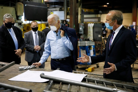 Democratic presidential candidate, former Vice President Joe Biden, center, listens to McGregor Industries owner Bob McGregor, right, give a tour of the metal fabricating facility, Thursday, July 9, 2020, in Dunmore, Pa. (AP Photo/Matt Slocum)