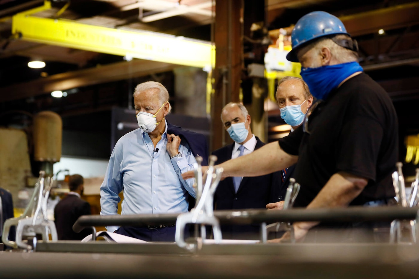 Democratic presidential candidate, former Vice President Joe Biden, from left, Sen. Bob Casey, D-Pa., and McGregor Industries owner Bob McGregor listen to First Class Fitter Michael Phillips during a tour of the metal fabricating facility, Thursday, July 9, 2020, in Dunmore, Pa. (AP Photo/Matt Slocum)