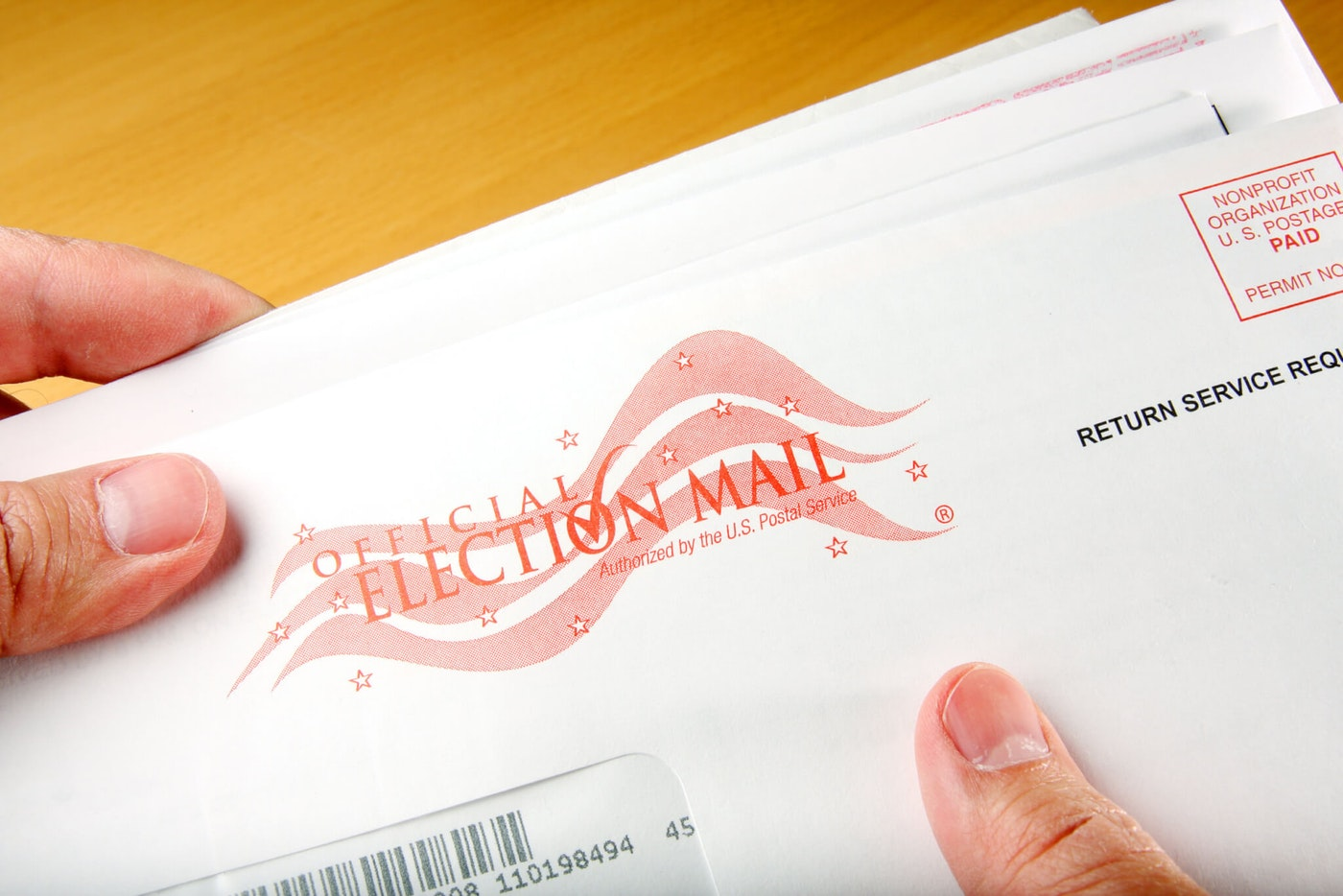 In a leap forward for voter access, Oakland County is the first county in the state that will pay for postage on all ballots returned by mail. (Photo via Shutterstock)