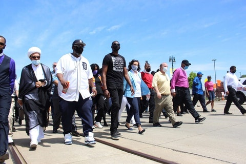 Lt. Gov.Garlin Gilchrist marches with Michiganders for equality. Photo via Facebook.