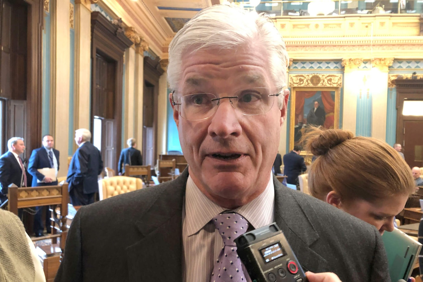 """FILE - In this Dec. 10, 2019, file photo, Michigan Senate Majority Leader Mike Shirkey, R-Clarklake, speaks to reporters inside the Senate in Lansing, Mich. Shirkey is opposing legislation that would ease Michigan election clerks' ability to process an expected influx of absentee ballots, saying it would set a """"dangerous precedent."""" Shirkey's stance — announced Wednesday, Feb. 19, 2020,— makes it unlikely that the proposed change will be enacted before the November presidential election. (AP Photo/David Eggert, File)"""