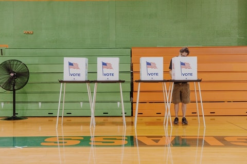 Despite the larger number of people taking advantage of Absentee Ballots, a few still choose to vote in person at the polls. Photo by Franz Knight.