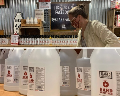 Ypsilanti-area art teacher Rachel Spall stocks up on hand sanitizer at Blake's Cider Mill in Armada Wednesday
