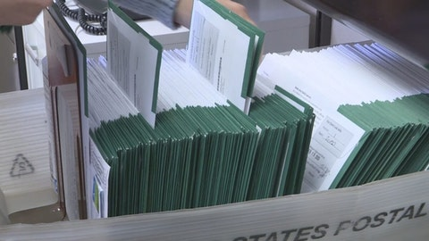 As the state gears up for its largest mail-in count in history, absentee ballots arrive at clerks' offices across Michigan by the bin. Photo via WSBT