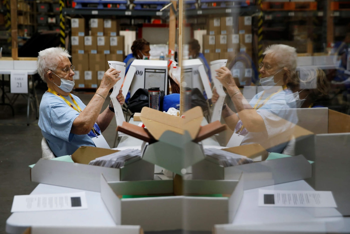 FILE - In this June 9, 2020, file photo, election workers process mail-in ballots during a nearly all-mail primary election  (AP Photo/John Locher, File)