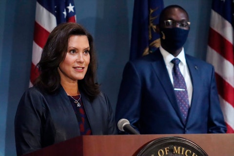FILE - In this Tuesday, Sept. 2, 2020 file photo provided by the Michigan Office of the Governor, Gov. Gretchen Whitmer addresses the state during a speech in Lansing, Mich., heir status amid the coronavirus pandemic. Whitmer says gyms can reopen after 5 1/2 months of closure and organized sports can resume if masks are worn. She lifted some coronavirus restrictions Thursday, Sept. 3, 2020, that lasted longer in Michigan than in many other states. The order, effective next Wednesday, allows for reopening fitness centers and indoor pools in remaining regions that hold 93% of Michigan's population.(Michigan Office of the Governor via AP)