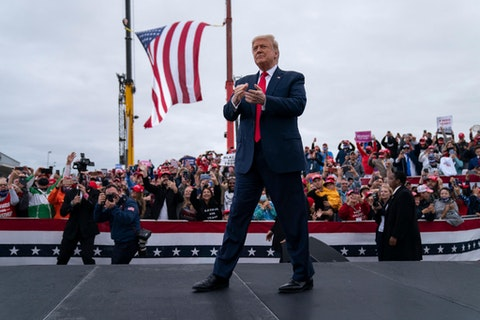 President Donald Trump arrives for a campaign rally at MBS International Airport, Thursday, Sept. 10, 2020, in Freeland, Mich. (AP Photo/Evan Vucci)