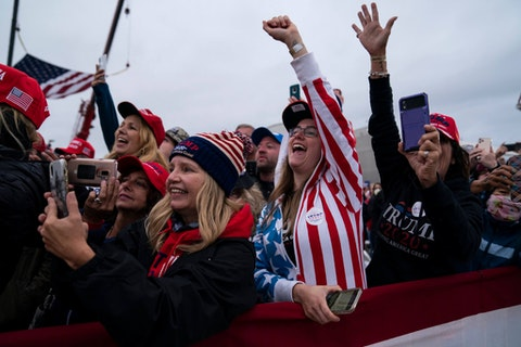 Supporters of President Donald Trump cheer as he arrives for a campaign rally at MBS International Airport, Thursday, Sept. 10, 2020, in Freeland, Mich. (AP Photo/Evan Vucci)