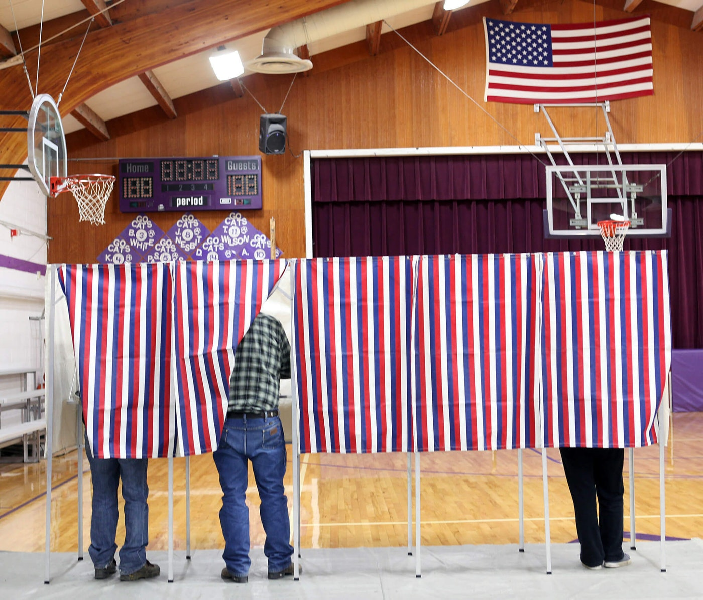 Voters cast their Election Day ballots at a rural high school (AP Photo/Janie Osborne)