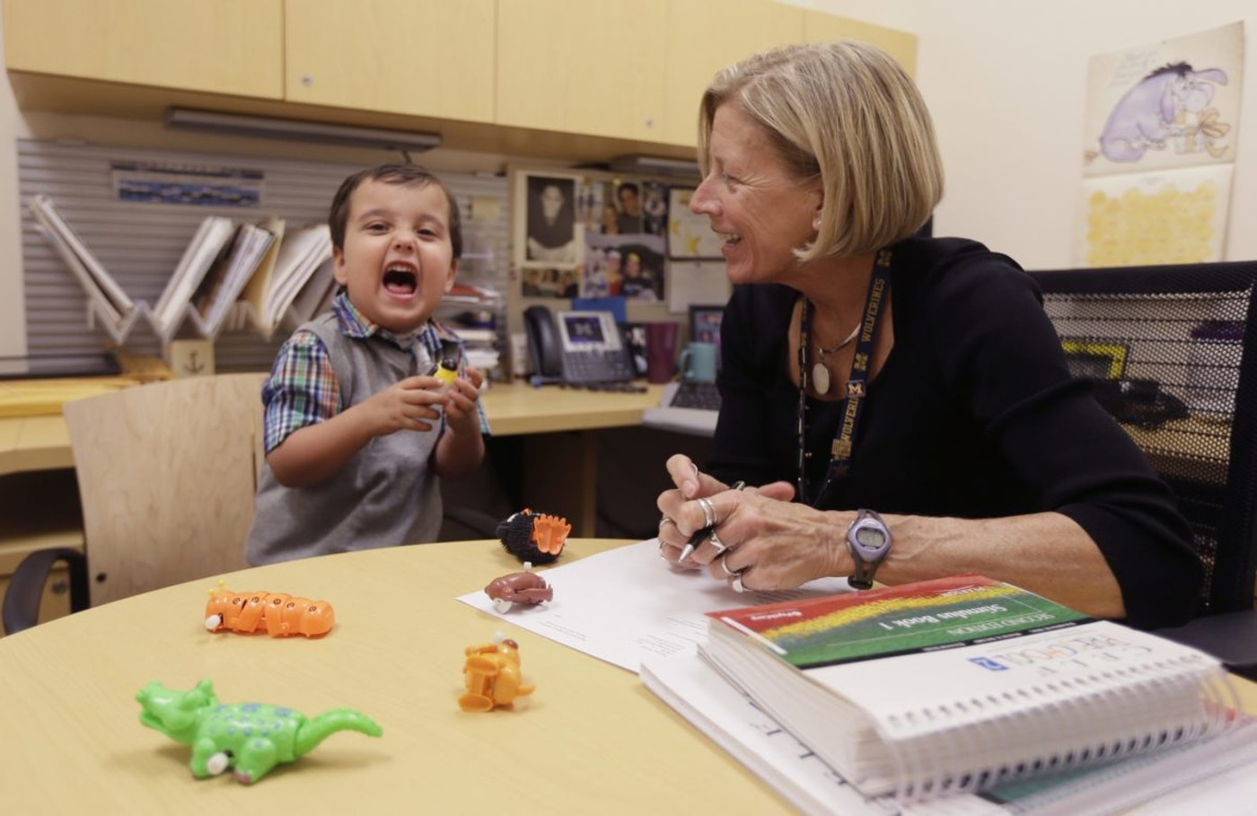 In a photo in Ann Arbor, Mich., Grant Hasse yells out a word next to Lynn Driver, a speech-language pathologist at the University of Michigan's C.S. Mott Children's Hospital. A speech pathologist is one of the job markets booming in Michigan. (AP)