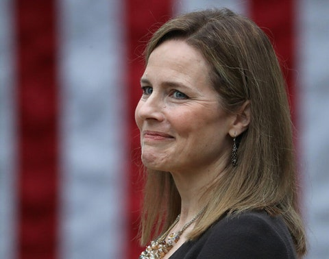 SEPTEMBER 26: Seventh U.S. Circuit Court Judge Amy Coney Barrett looks on while being introduced by U.S. President Donald Trump as his nominee to the Supreme Court during an event in the Rose Garden at the White House September 26, 2020 in Washington, DC. With 38 days until the election, Trump tapped Barrett to be his third Supreme Court nominee in just four years and to replace the late Associate Justice Ruth Bader Ginsburg, who will be buried at Arlington National Cemetery on Tuesday. (Photo by Chip Somodevilla/Getty Images)