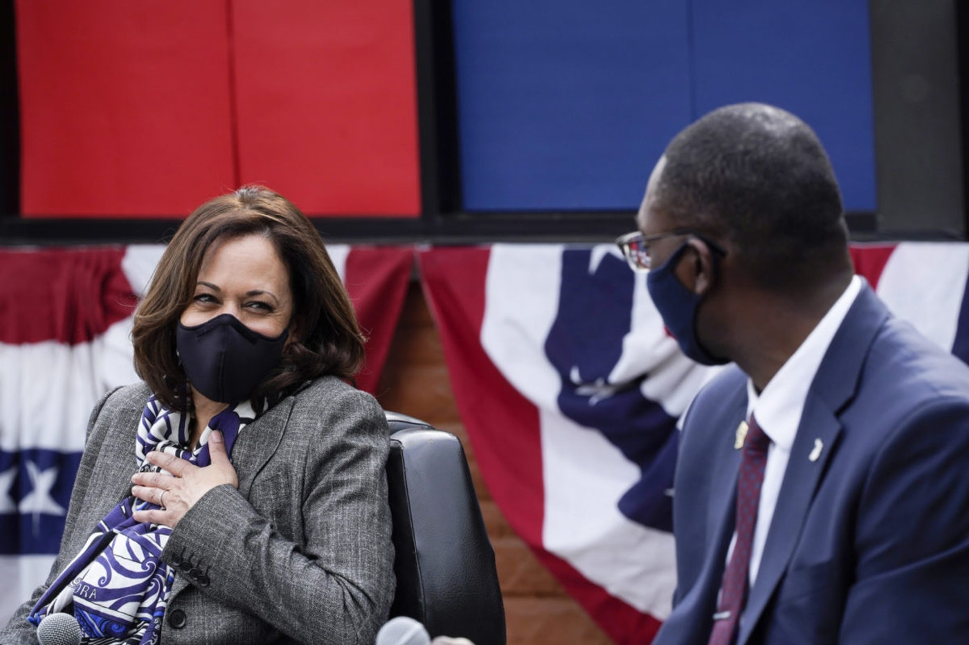 Democratic vice presidential candidate Sen. Kamala Harris, D-Calif., listens to Michigan Lt. Governor Garlin Gilchrist II at Headliners Barbershop in Detroit, Tuesday, Sept. 22, 2020. (AP Photo/Paul Sancya)