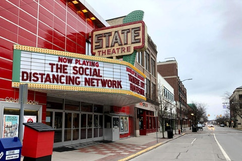 In this March 18 photo a tongue-in-cheek message is displayed on the marquee of the State Theatre in Traverse City, Mich. The historic theater hosts the Traverse City Film Festival, led by documentary filmmaker Michael Moore, which is among many summer festivals and events in the tourist-friendly community that have been canceled because of the coronavirus. Movie theaters are picking up steam, now.