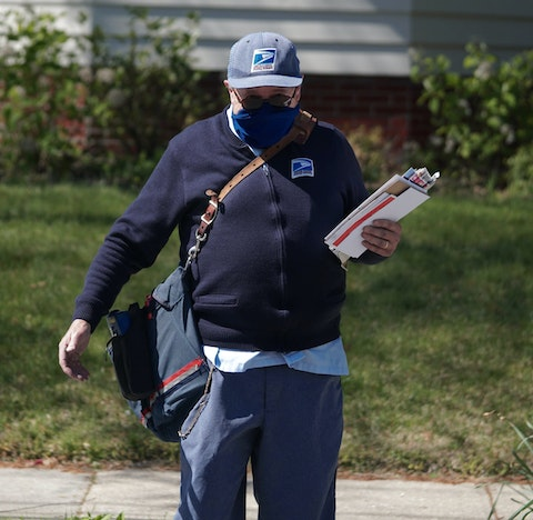 Mail carrier, Richard Sowden, of the USPS delivers mail during the coronavirus pandemic.