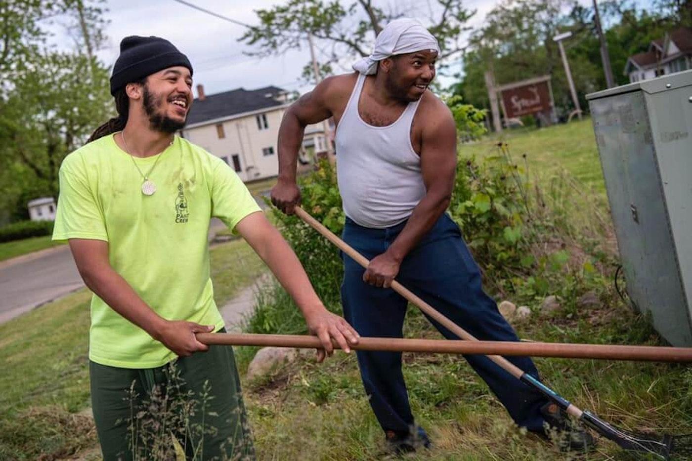 President & CEO Devon Wilson hard at work with Sunlight Gardens volunteer.