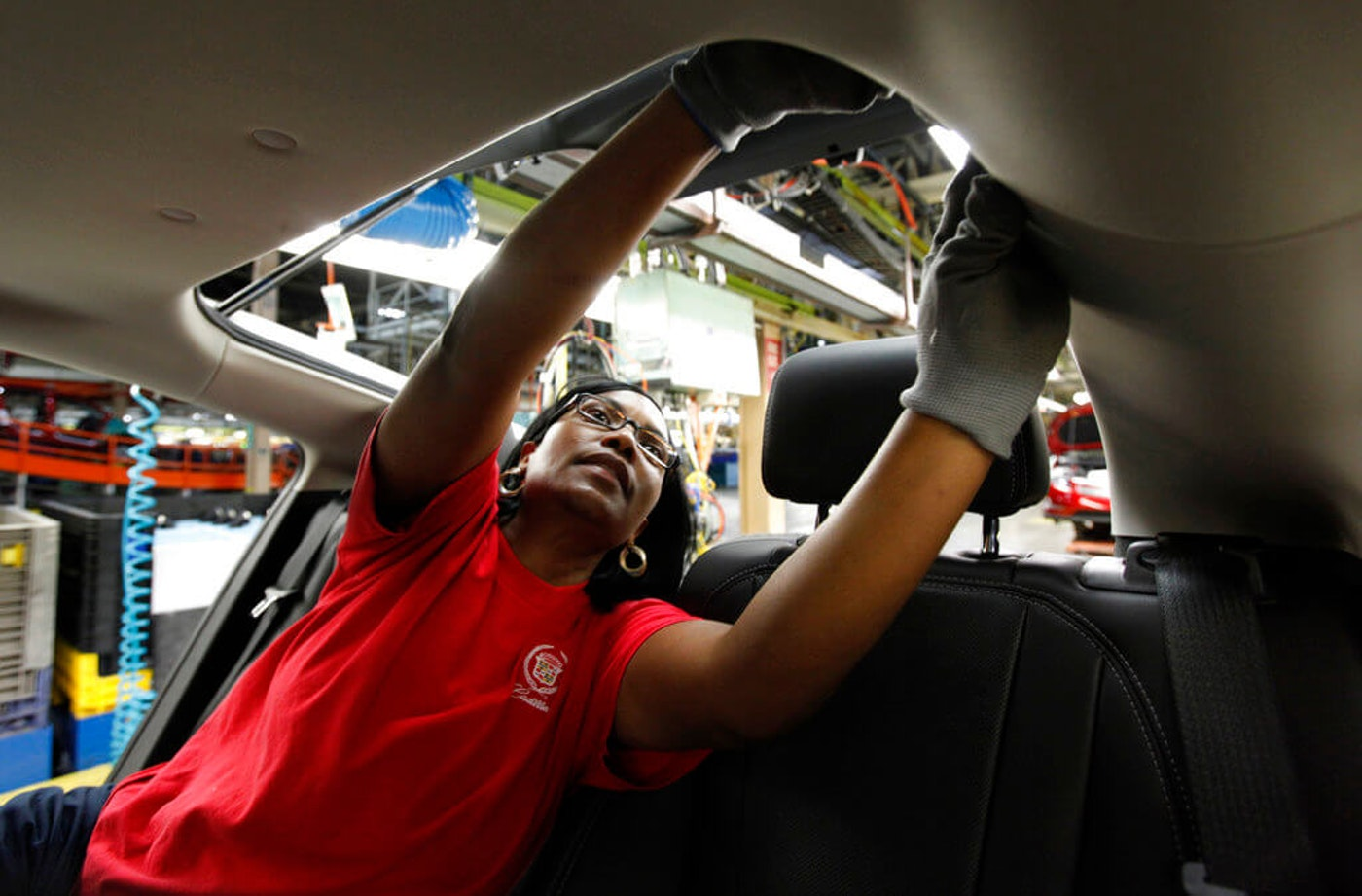 Assembly worker Julaynne Trusel works on a Chevrolet Volt at the General Motors Hamtramck Assembly plant in Hamtramck. (AP)