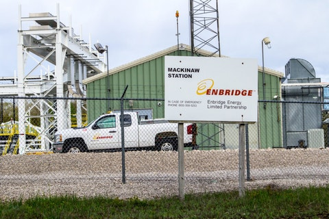 Mackinaw City, Michigan, USA - May 30, 2020: Exterior of Enbridge Inc. oil pump station at the Straits of Mackinaw. The company transports nearly two thirds of Canada's crude oil exports to the US.