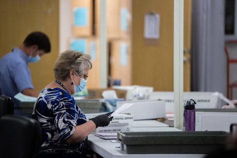 Working the polls this election season takes a lot of grit and grace. See how one poll worker is handling it.